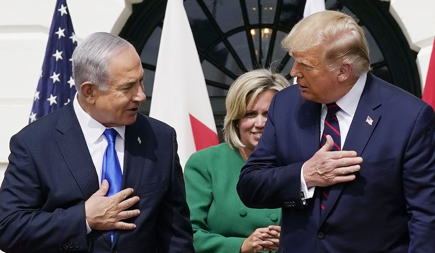 President Donald Trump speaks with Israeli Prime Minister Benjamin Netanyahu during the Abraham Accords signing ceremony on the South Lawn of the White House, Tuesday, Sept. 15, 2020, in Washington. (AP Photo/Alex Brandon)