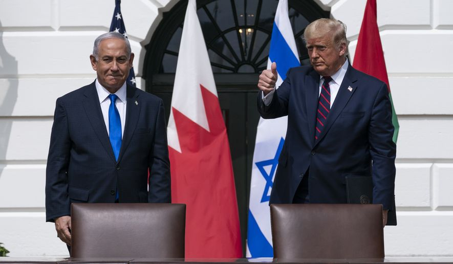 Israeli Prime Minister Benjamin Netanyahu, left, and President Donald Trump stand to depart the Abraham Accords signing ceremony on the South Lawn of the White House, Tuesday, Sept. 15, 2020, in Washington. (AP Photo/Alex Brandon)
