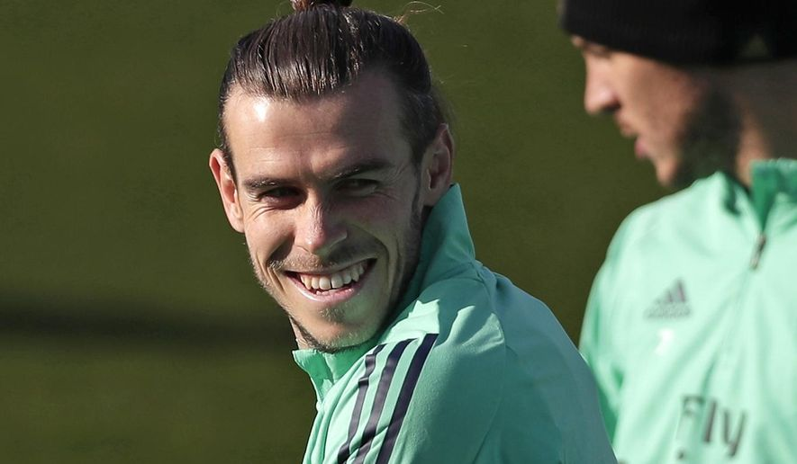 FILE - In this Monday, Nov. 25, 2019 file photo, Real Madrid's Gareth Bale takes part in a training session at the team's Valdebebas training ground in Madrid, Spain. Out of favor at Real Madrid, Gareth Bale is hoping to secure a return to Premier League club Tottenham. Bale's agent, Jonathan Barnett, confirmed to The Associated Press that he is in talks with Tottenham Hotspur. (AP Photo/Manu Fernandez, File)