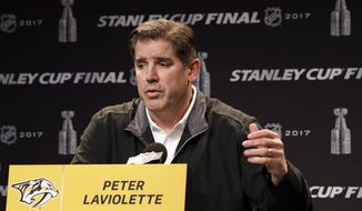 FILE - Nashville Predators head coach Peter Laviolette answers questions during a news conference Thursday, June 1, 2017, in Nashville, Tenn. The Washington Capitals hired Peter Laviolette, who won the Stanley Cup with the Carolina Hurricanes in 2006, as coach on Tuesday, Sept. 15, 2020. (AP Photo/Mark Humphrey, FIle)