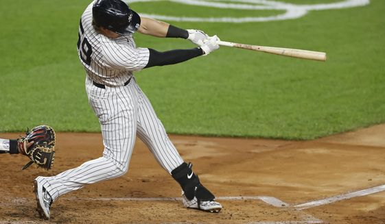 CORRECTS TO SECOND INNING-New York Yankees' Luke Voit hits a three-run home run during the second inning of a baseball game against the Toronto Blue Jays on Tuesday, Sept. 15, 2020, in New York. (AP Photo/Adam Hunger)