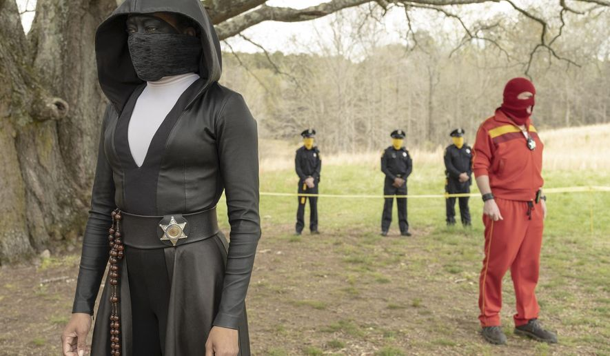 """This image released by HBO shows Regina King in a scene from """"Watchmen."""" The series is nominated for 26 Emmy Awards including one for outstanding limited series.  (Mark Hill/HBO via AP)"""