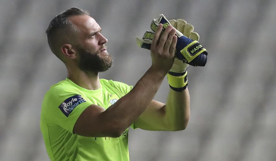 FILE - In this Thursday, Aug. 1, 2019 file photo, Shamrock Rovers' goalkeeper Alan Mannus after the Europa League second leg second qualifying round soccer match between Apollon Limassol and Shamrock Rovers at GSP stadium, in Nicosia, Cyprus. Irish soccer is buzzing with one of the biggest clubs in European soccer making its return to the Emerald Isle on Thursday Sept. 17, 2020. AC Milan expects to have Zlatan Ibrahimovic in tow against Shamrock Rovers in Europa League qualifying for its first competitive game on Irish soil since 1975. (AP Photo/Petros Karadjias, File)