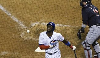 Chicago Cubs' Cameron Maybin reacts after being hit by a pitch with the bases loaded, scoring the winning run during the ninth inning of the team's baseball game against the Cleveland Indians, Tuesday, Sept.15, 2020, in Chicago. (AP Photo/David Banks)