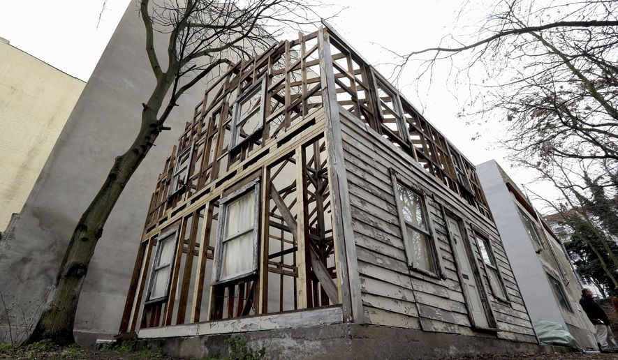This Dec. 12, 2017, file photo shows the rebuilt house of the civil rights activist Rosa Parks in Berlin, Germany. The rundown, paint-chipped Detroit house where U.S. civil rights campaigner Rosa Parks took refuge after her historic bus boycott is going on display on Tuesday, Sept. 15, 2020, in Italy in a setting that couldn't be more incongruous: the imposing central courtyard of the 18th century Royal Palace in Naples, southern Italy. (AP Photo/Michael Sohn, file)