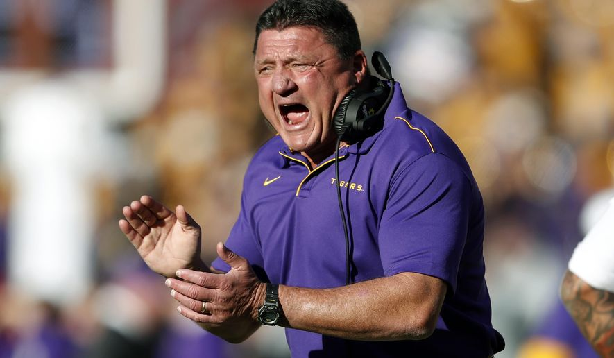 In this Saturday, Nov. 9, 2019 file photo, LSU head coach Ed Orgeron reacts after a LSU touchdown in the first half of an NCAA football game against Alabama in Tuscaloosa, Ala. This is the rare SEC team whose schedule might have gotten a tad easier by playing a conference-only slate. The SEC opponents added to LSU's schedule last month were Missouri (6-6 last season) and Vanderbilt (3-9). LSU had to drop a scheduled home date with No. 14 Texas, though its other non-conference games would have been lackluster matchups with Rice, Nicholls and Texas-San Antonio. (AP Photo/John Bazemore, File)