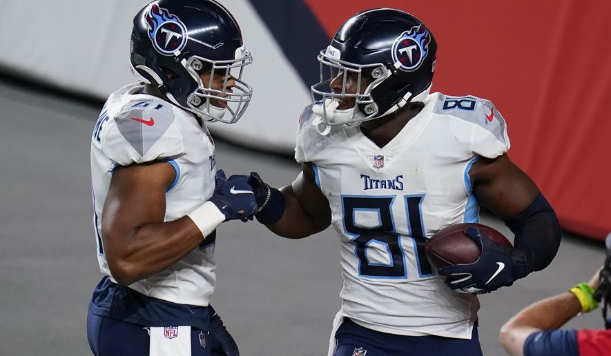 Tennessee Titans tight end Jonnu Smith (81) celebrates his touchdown catcha with running back Khari Blasingame during the second half of an NFL football game against the Denver Broncos, Monday, Sept. 14, 2020, in Denver. (AP Photo/Jack Dempsey)
