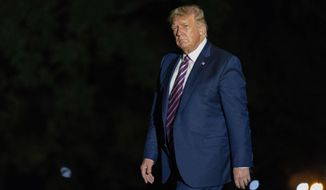 President Donald Trump walks on the South Lawn as he arrives at the White House, Monday, Sept. 14, 2020, in Washington from a trip to Phoenix. (AP Photo/Manuel Balce Ceneta)