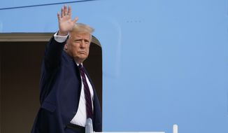 President Donald Trump waves from the top of the steps of Air Force One at Andrews Air Force Base in Md., Tuesday, Sept. 15, 2020. Trump is heading to Philadelphia for a town hall event hosted by ABC News. (AP Photo/Susan Walsh)