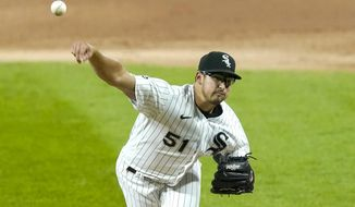 Chicago White Sox starting pitcher Dane Dunning delivers during the first inning of the team's baseball game against the Minnesota Twins on Tuesday, Sept. 15, 2020, in Chicago. (AP Photo/Charles Rex Arbogast)