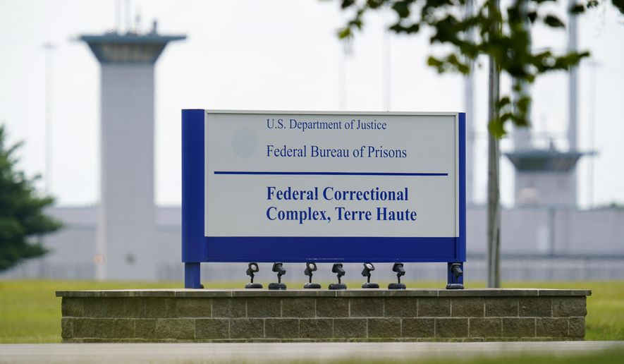 FILE - In this Aug. 28, 2020, file photo, the federal prison complex in Terre Haute, Ind. Two inmates have died in as many days from coronavirus at the federal prison complex where the U.S. government plans to carry out two federal executions next week.  (AP Photo/Michael Conroy, File)