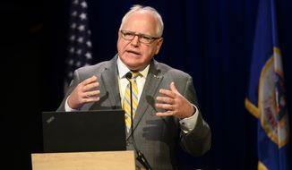 Minnesota Gov. Tim Walz takes part in a news conference to announce the learning plan for Minnesota schools for the upcoming 2020-21 school year at TPT's St. Paul, Minn., studio Thursday, July 30, 2020. (Aaron Lavinsky/Star Tribune via AP, Pool)
