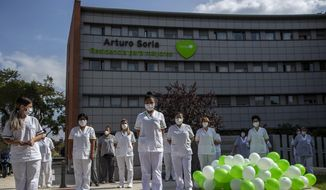 "Workers of a nursing home ""DomusVi Arturo Soria"" hold a minute of silence in support of the social and health sector and its workers in Madrid, Spain, Tuesday, Sept. 15, 2020. After ending a strict lockdown in June having brought under control the virus transmission, Spain is now the European country where a second wave of the contagion is being more noticed. (AP Photo/Manu Fernandez)"