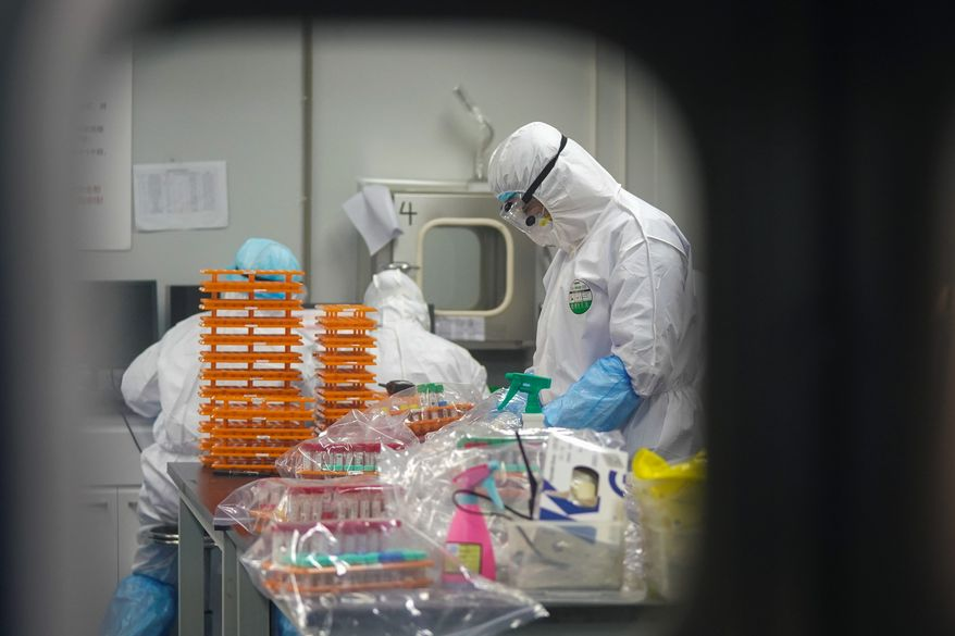 Information about China's biological arms program has reached U.S. intelligence agencies, thanks to a defector who is now in European protection. (Associated Press/File)