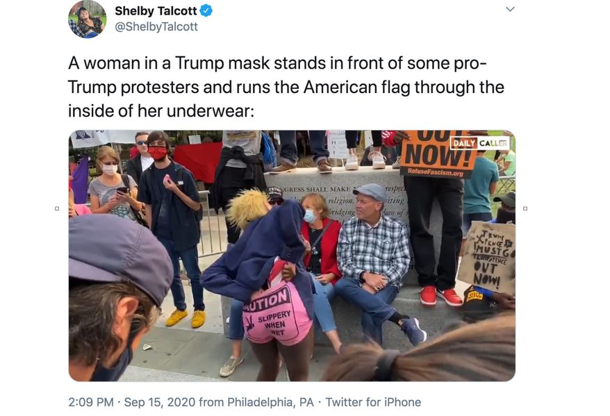 An anti-Trump protester in Philadelphia uses the American flag as a form of floss and runs it through her pants, Sept. 15, 2020. (Image: Twitter, Shelby Talcott of The Daily Caller, tweet screenshot)