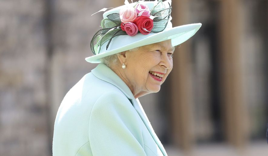 In this July 17, 2020 file photo, Britain's Queen Elizabeth smiles after awarding Captain Sir Thomas Moore his knighthood during a ceremony at Windsor Castle in Windsor, England. The former British colony of Barbador, once known as Little England, announced Tuesday, Sept. 15, that it plans to replace the monarch with its own head of state in time for next years 55th independence anniversary. (AP Photo/Chris Jackson, File)  **FILE**