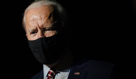 Democratic presidential candidate former Vice President Joe Biden speaks with reporters before boarding a plane at Orlando International Airport in Orlando, Fla., Tuesday, Sept. 15, 2020. Biden is returning to his home in Delaware after attending campaign events in Florida. (AP Photo/Patrick Semansky)