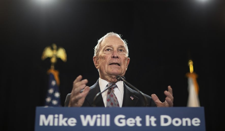 In this Feb. 5, 2020, file photo, then-Democratic presidential candidate and former New York City Mayor Michael Bloomberg speaks at a campaign event in Providence, R.I. Bloomberg has come through on his vow to spend whatever it takes to defeat President Donald Trump. The former presidential candidate has pledged to spend $100 million in Florida to boost Joe Biden there. (AP Photo/David Goldman) **FILE**