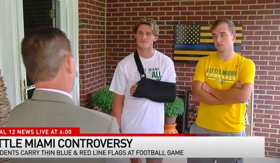 Brady Williams, a cornerback at Little Miami High School whose father is a police officer, and Jared Bentley, a linebacker at the school whose dad is a firefighter, carried a Thin Blue Line flag and a Thin Red Line flag, respectively, in commemoration of the police officers and firefighters who died in September 11, 2001 terrorist attacks. The act got them briefly suspended on Monday, Sept. 14, 2020. (Screen grab via WKRC)