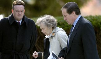 In this Nov. 23, 2005, file photo, New England Patriots head coach Bill Belichick, right, escorts his mother Jeannette as they leave the Naval Academy Chapel in Annapolis, Md., where they attended a funeral service for his father Steve Belichick. Jeannette Belichick died Monday, Sept. 14, 2020, from natural causes in Annapolis, Md. She was 98. (AP Photo/Matthew S. Gunby, File)  **FILE**
