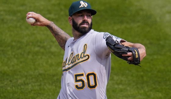 Oakland Athletics starting pitcher Mike Fiers (50) throws against the Colorado Rockies during the first inning of a baseball game, Wednesday, Sept. 16, 2020, in Denver. (AP Photo/Jack Dempsey)