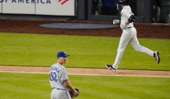 Toronto Blue Jays' Jacob Waguespack reacts as New York Yankees' Kyle Higashioka runs the bases after hitting a home run during the sixth inning of a baseball game Wednesday, Sept. 16, 2020, in New York. (AP Photo/Frank Franklin II)