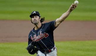 Atlanta Braves starting pitcher Cole Hamels throws a pitch to the Baltimore Orioles during the first inning of a baseball game, Wednesday, Sept. 16, 2020, in Baltimore. (AP Photo/Julio Cortez)
