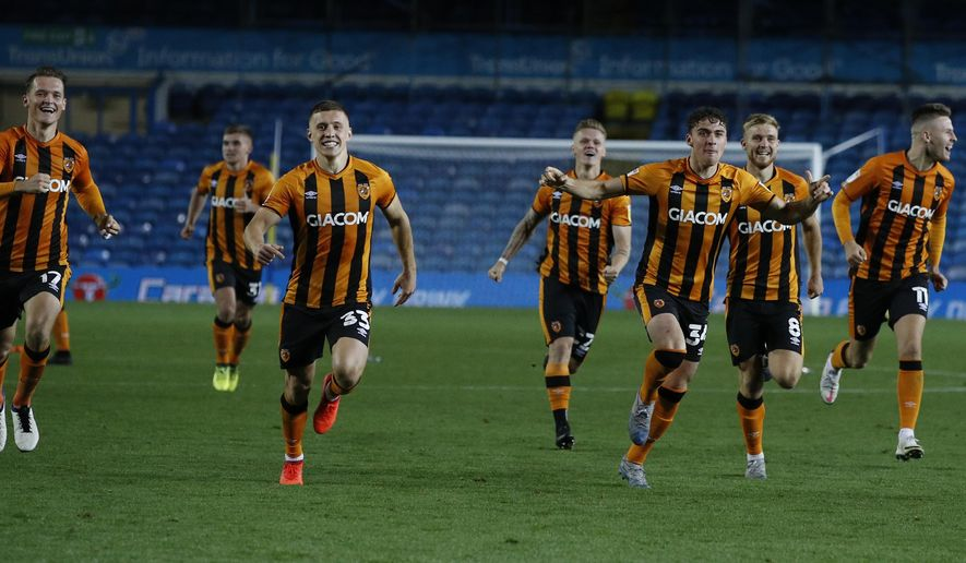 Hull's players run to celebrate after their winning penalty following the penalty shootout, during the English League Cup soccer match between Leeds United and Hull in Leeds, England, Wednesday, Sept. 16, 2020. (Phil Noble/Pool via AP)