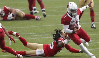 Arizona Cardinals quarterback Kyler Murray (1) runs past San Francisco 49ers cornerback Richard Sherman to score a touchdown during the second half of an NFL football game in Santa Clara, Calif., Sunday, Sept. 13, 2020. (AP Photo/Josie Lepe)