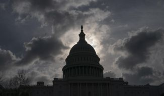 FILE - In this April 12, 2019, file photo, morning clouds cover Capitol Hill in Washington, as Congress leaves for a two week recess. Philanthropy is stepping in to fund U.S. elections during the coronavirus pandemic. This comes after Congress has failed to approve additional funding to help election officials adjust to an expected avalanche of mail ballots and need to sanitize polling places. (AP Photo/J. Scott Applewhite, File)