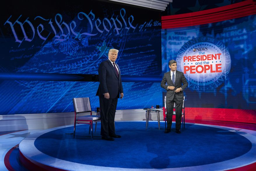 President Donald Trump and ABC News anchor George Stephanopoulos arrive to tape a town hall at National Constitution Center, Tuesday, Sept. 15, 2020, in Philadelphia. (AP Photo/Evan Vucci)