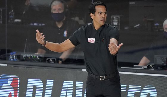 Miami Heat head coach Erik Spoelstra gestures to his team during the second half of an NBA conference final playoff basketball game against the Boston Celtics on Tuesday, Sept. 15, 2020, in Lake Buena Vista, Fla. (AP Photo/Mark J. Terrill)