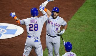 New York Mets' J.D. Davis (28) and Dominic Smith (2) celebrate after Davis' two-run home run off Philadelphia Phillies pitcher Zack Wheeler during the sixth inning of a baseball game, Wednesday, Sept. 16, 2020, in Philadelphia. (AP Photo/Matt Slocum)
