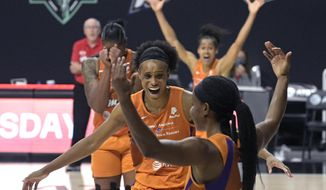 Phoenix Mercury guard Shey Peddy, front, and teammates forward Brianna Turner, center, center Kia Vaughn, left, and guard Skylar Diggins-Smith, rear, react after Peddy scored the game-winning shot as time expired during the team's WNBA basketball first-round playoff game against the Washington Mystics on Tuesday, Sept. 15, 2020, in Bradenton, Fla. (AP Photo/Phelan M. Ebenhack)