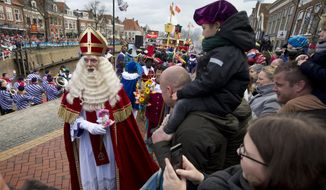 FILE - In this Saturday, Nov. 18, 2017 file photo, Sinterklaas, or Saint Nicholas, arrives in Dokkum, northern Netherlands. The annual nationally televised arrival in the Netherlands of Saint Nicholas, known locally as Sinterklaas, will happen without public this year because of concerns about the coronavirus, the broadcaster that organizes the event announced Wednesday, Sept. 16, 2020. (AP Photo/Peter Dejong, file)