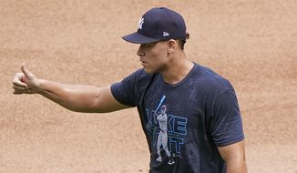 New York Yankees right fielder Aaron Judge, who is on the injured list, gives a thumbs up to the Yankees bench coach after fielding a few balls in the outfield before the start of a baseball game, Sunday, Sept. 13, 2020, at Yankee Stadium in New York. (AP Photo/Kathy Willens)