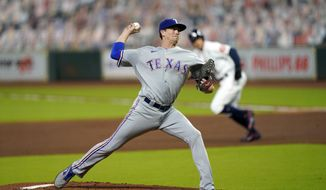 Texas Rangers starting pitcher Kyle Gibson throws against the Houston Astros during the first inning of a baseball game Wednesday, Sept. 16, 2020, in Houston. (AP Photo/David J. Phillip)