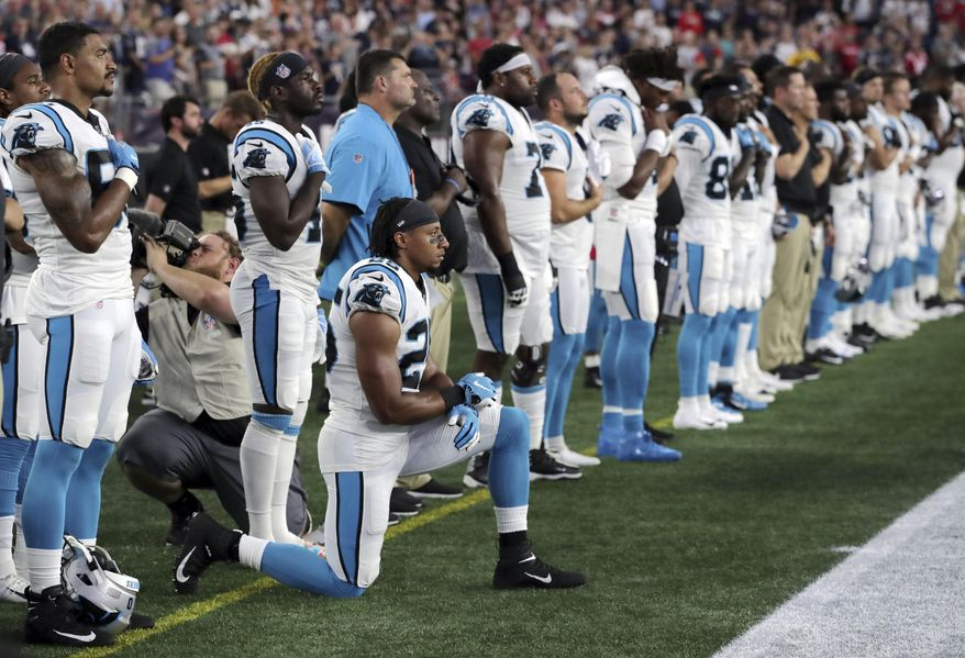 """In this Aug. 22, 2019, file photo, Carolina Panthers strong safety Eric Reid (25) kneels during the national anthem before the team's NFL preseason football game against the New England Patriots in Foxborough, Mass. Despite setting two defensive franchise records for the Panthers last season, Reid remains unsigned like his close friend Colin Kaepernick. Washington coach Ron Rivera, Reid's former coach in Carolina, gave him a strong endorsement Wednesday, Sept. 16. """"I would tell them he's a heckuva teammate,"""" Rivera said. """"He came in and the young man did exactly what was asked of him."""" (AP Photo/Charles Krupa, File)  **FILE**"""