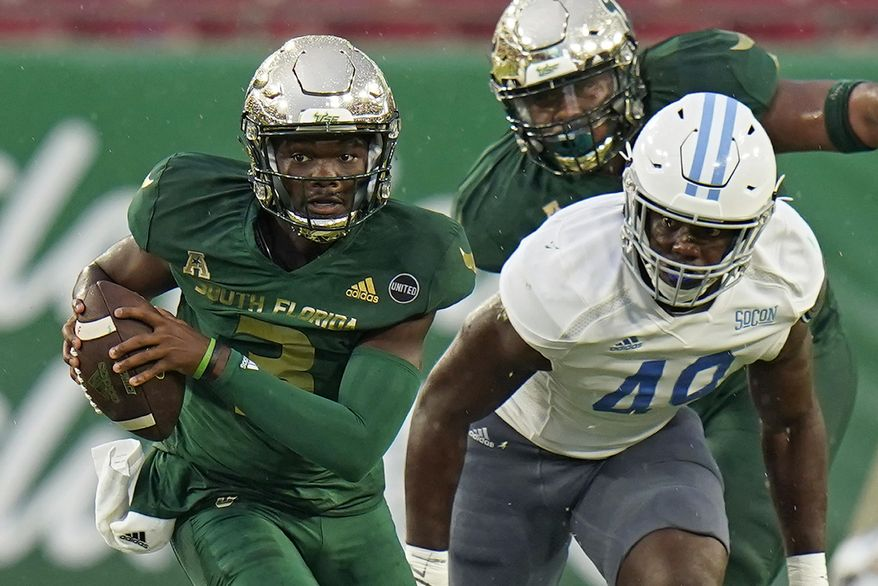 South Florida quarterback Jordan McCloud (3) breaks away from Citadel linebacker Marquise Blount (49) during the first half of an NCAA college football game Saturday, Sept. 12, 2020, in Tampa, Fla. (AP Photo/Chris O'Meara)