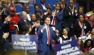FILE - In this June 20, 2020 file photo, Oklahoma Gov. Kevin Stitt is recognized as President Donald Trump speaks during a campaign rally at the BOK Center in Tulsa, Okla. Oklahoma's former state epidemiologist warned as many as nine deaths and 228 new cases of coronavirus could result from President Donald Trump's June rally in Tulsa, according to documents released Wednesday, Sept. 16, 2020, by the Oklahoma State Department of Health show. (AP Photo/Sue Ogrocki, File)