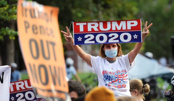 """Social unrest has emerged as key topic for voters after months of protests. President Trump calls himself a """"law and order"""" leader. (Associated Press)"""