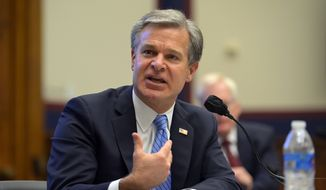 FBI Director Christopher Wray testifies before a House Committee on Homeland Security hearing Thursday, Sept. 17, 2020, on Capitol Hill Washington. (John McDonnell/The Washington Post, Pool via AP) ** FILE **