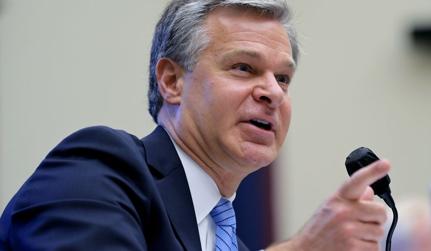 Federal Bureau of Investigation Director Christopher Wray testifies before a House Committee on Homeland Security hearing on 'worldwide threats to the homeland', Thursday, Sept. 17, 2020 on Capitol Hill Washington. (John McDonnell/The Washington Post via AP, Pool)