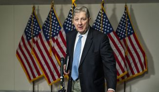 Sen. John Kennedy, R-La., speaks to reporters as he leaves the Senate Republican policy meeting on Capitol Hill, Thursday, Sept. 17, 2020, in Washington. (AP Photo/Manuel Balce Ceneta)