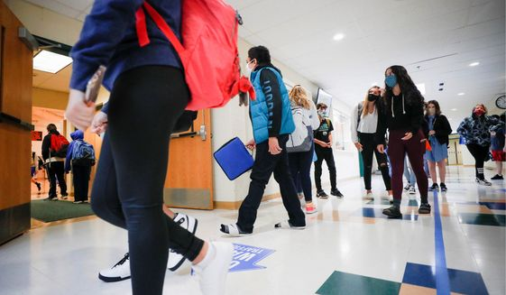 As students return to classrooms this fall, President Trump and Democratic presidential nominee Joseph R. Biden are laying out vastly different visions for education policies in America. (Associated Press)