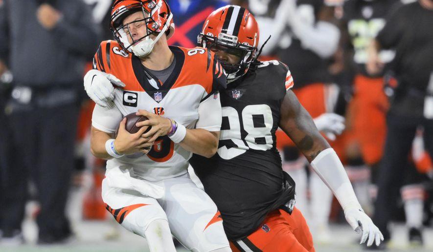 Cleveland Browns defensive tackle Sheldon Richardson (98) sacks Cincinnati Bengals quarterback Joe Burrow (9) during the first half of an NFL football game Thursday, Sept. 17, 2020, in Cleveland. (AP Photo/David Richard)