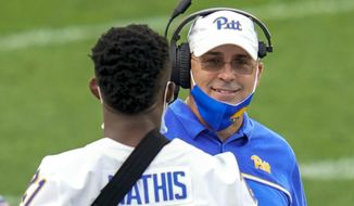Pittsburgh coach Pat Narduzzi talks wit Damarri Mathis during the second half of the team's NCAA college football game against Austin Peay, Saturday, Sept. 12, 2020, in Pittsburgh. (AP Photo/Keith Srakocic)