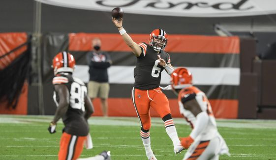 Cleveland Browns quarterback Baker Mayfield throws a pass during the first half of an NFL football game against the Cincinnati Bengals, Thursday, Sept. 17, 2020, in Cleveland. (AP Photo/David Richard)