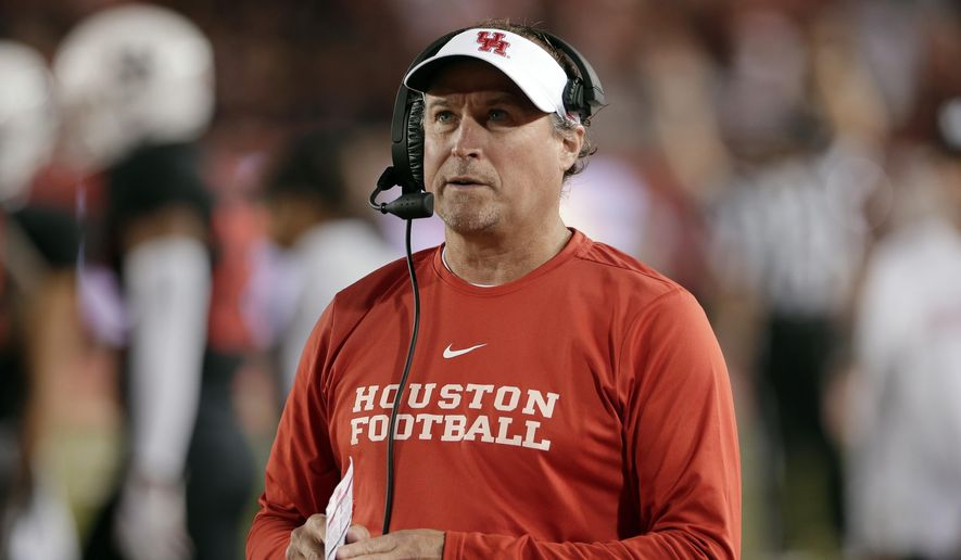 In this Oct. 24, 2019, file photo, Houston coach Dana Holgorsen watches during the second half of the team's NCAA college football game against SMU in Houston. Holgorsen, in his second year at Houston, and the Cougars face Baylor this week, in the first meeting between the schools since 1995. (AP Photo/Michael Wyke, File)  **FILE**