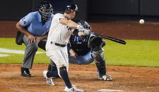 New York Yankees' Brett Gardner hits a two-run home run during the fourth inning of the team's baseball game against the Toronto Blue Jays on Thursday, Sept. 17, 2020, in New York. (AP Photo/Frank Franklin II)